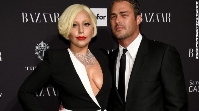 141015102037-lady-gaga-taylor-kinney-september-2014-story-top